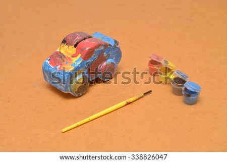 Car ceramic piggy bank With colors to vent. - stock photo