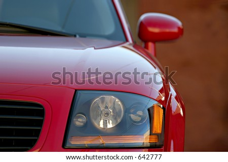 car closeup, shallow depth of field with focus on headlight - stock photo
