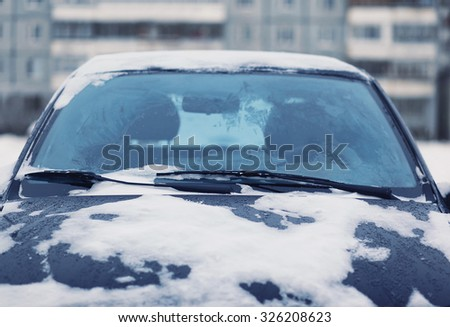 Car covered with snow, frozen winter, view windshield - stock photo