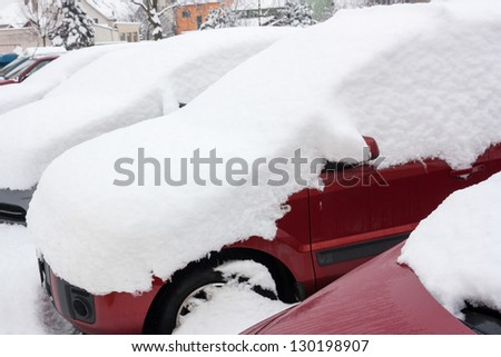 car covered with snow in winter - stock photo