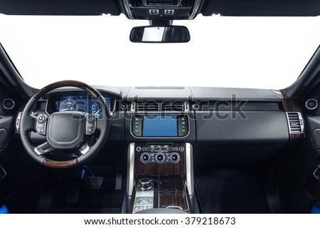 Car dashboard & steering wheel. Interior of prestige modern car. Black cockpit with exclusive wood & metal decoration on isolated white background. - stock photo