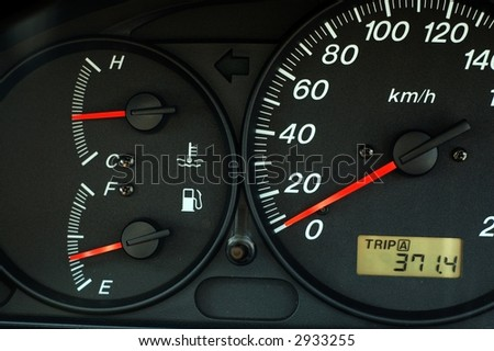 Car dashboard with speed, temperature and fuel indicator - stock photo