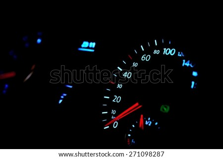 Car dashboard with speedometer, glow in the dark - stock photo