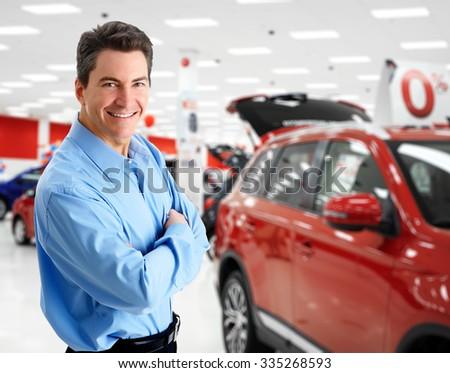 Car dealer man. Auto dealership and rental concept background. - stock photo