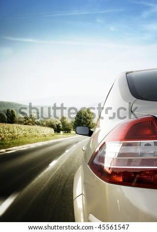 Car detail - back side, half. On the road. - stock photo