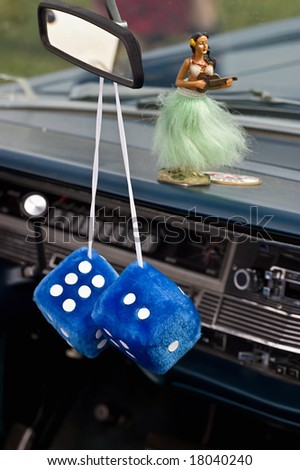 Car dice in a old american car - stock photo