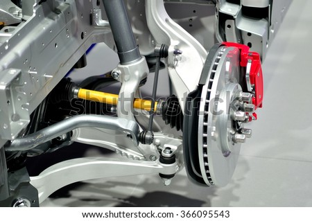 Car disc brake with red caliper, and  front suspension. - stock photo