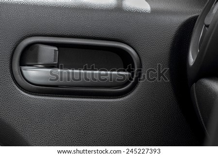 Car door handle from inside - stock photo