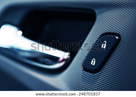 Car Door Lock Button Closeup. Electric Locking Button in Modern Car. - stock photo