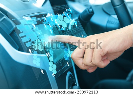 Car driver hands with GPS, Pushing on car screen interface with entering an address into the navigation system - stock photo