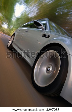 Car driving at speed - stock photo
