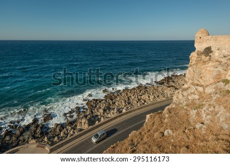 Car driving by Rethymno fortress in Crete, Greece - stock photo