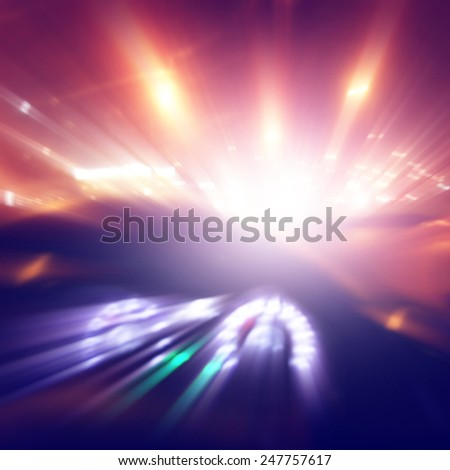 Car driving fast at sunset. Blurred motion image. - stock photo