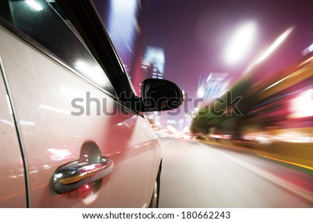 Car driving fast down in the city - stock photo