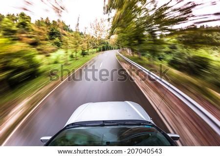 car driving fast, POV - stock photo