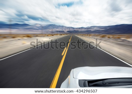 Car driving on an interstate or highway. Motion blur from speed - stock photo