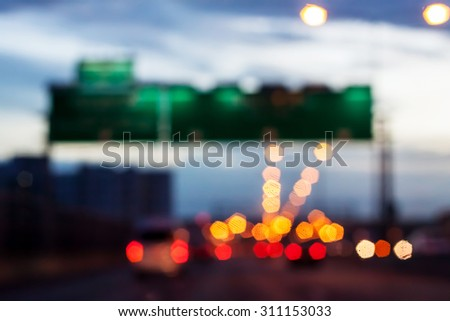car driving on road with traffic jam in the city, abstract blurred background - stock photo