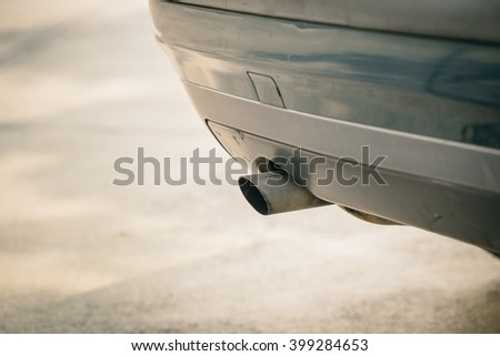 car emission smoke out exhaust pipe with carbon monoxide pollution. - stock photo