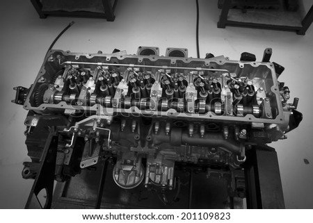 Car engine head two camshaft system, pulley, belt and injectors - stock photo