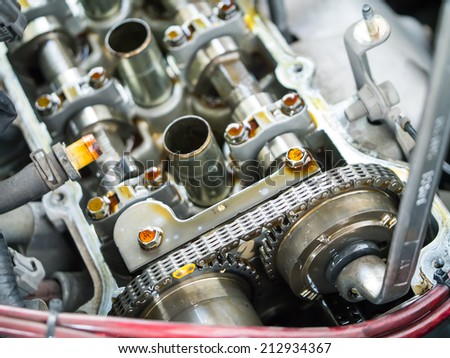 Car engine inspection adjusting shaft and valve for the best performance - stock photo