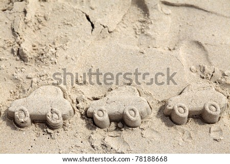 Car figure made of sand on Beach. Traveling by car - stock photo