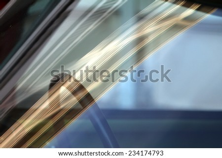 car glass with beautiful reflections and part of interior behind it - stock photo