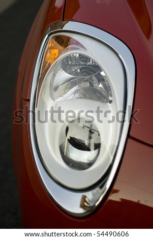 Car headlight - stock photo