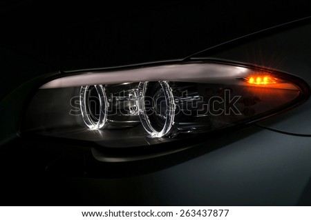 Car headlight with backlight. Exterior detail. - stock photo