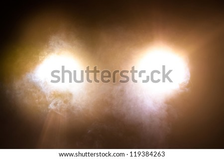 Car Headlights of a car at night - stock photo