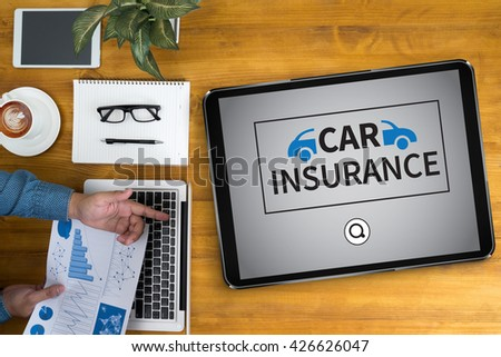 CAR INSURANCE Businessman working at office desk and using computer and objects, coffee, top view, - stock photo