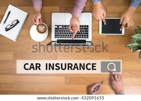 CAR INSURANCE man touch bar search and Two Businessman working at office desk and using a digital touch screen tablet and use computer, top view - stock photo