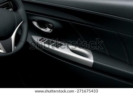 Car interior detail. Closeup of controls on the door - stock photo
