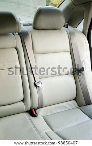 Car interior, gray car back seats with headrest - stock photo