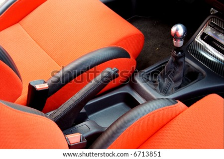 Car interior. Red upholstery - stock photo