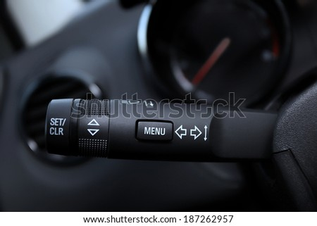 Car interior with turn signal switch  - stock photo
