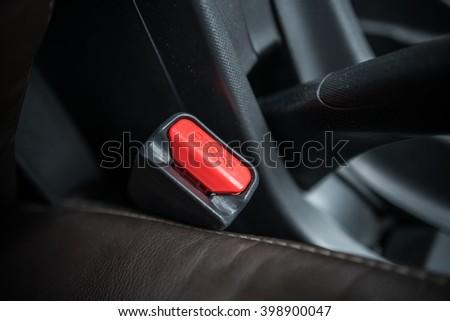 Car interiors ; Seatbelt lock - safety belt equipment  - stock photo