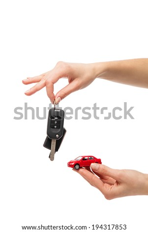 Car Key Concept Illustration : Two hand holding exchanging red colored car with automatic key - stock photo