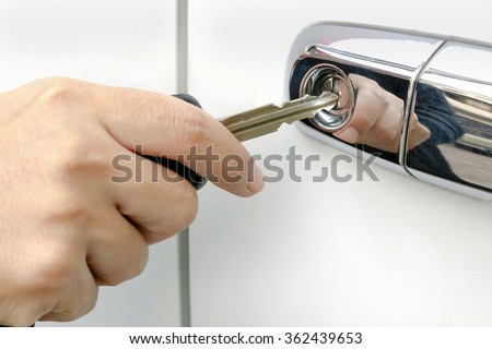 Car key inserted into the lock hole - stock photo