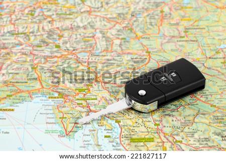 Car key on street map travel concept - stock photo