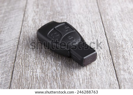 car key on the wooden table, close up photo - stock photo