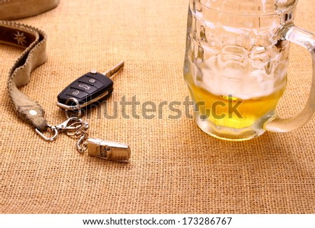 Car key with a tilted trailer and beer mug, close up - stock photo