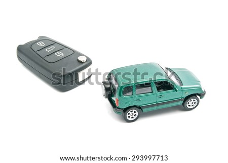 car keys and green car on white - stock photo
