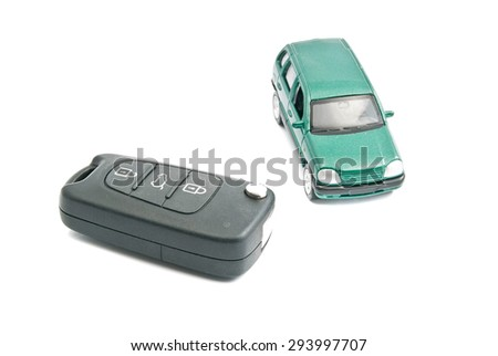 car keys and green car on white background - stock photo