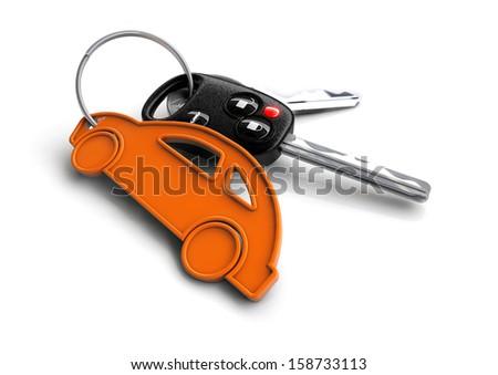 Car keys attached to a orange key ring shaped like a car.  - stock photo