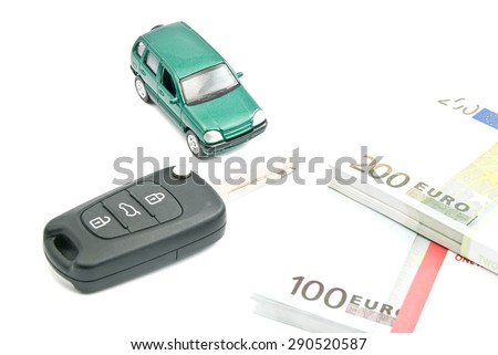 car keys, euro notes and green car on white - stock photo