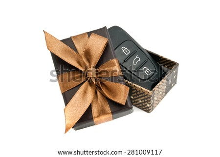 car keys in brown gift box on white - stock photo