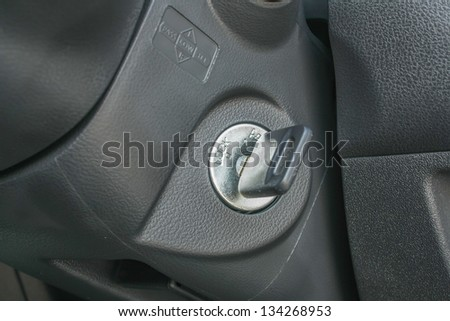 Car keys in ignition,and start the car - stock photo