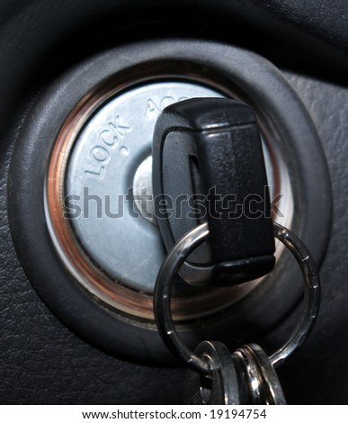 car keys in ignition, engine is on. - stock photo
