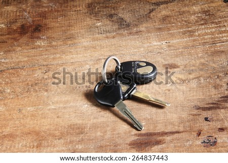 car keys on a wooden floor - stock photo
