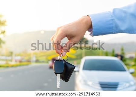 Car Keys. Seller hand giving keys - stock photo